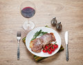 Sirloin steak with rosemary and cherry tomatoes on a plate wine view from above Royalty Free Stock Image