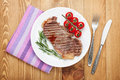 Sirloin steak with rosemary and tomatoes cherry on a plate view from above Royalty Free Stock Photo