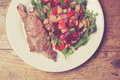 Sirloin steak and salad Royalty Free Stock Photo