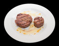 Sirloin steak on white plate black background Stock Image
