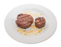 Sirloin steak on white plate white background Stock Images