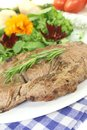 Sirloin steak with wild herb salad and rosemary Royalty Free Stock Photo