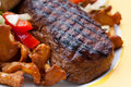 Sirloin strip steak with baked potato and chantere Royalty Free Stock Photo