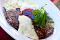 Sirloin strip Steak with vegetables and savory bec Stock Photos