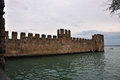 Sirmione fortress alongside lago di garda ancient at Royalty Free Stock Images