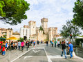 Sirmione, Italy - September 20, 2014: The people going to the Scaliger Castle. Royalty Free Stock Photo