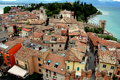 Sirmione italy view over orange tile rooftops of the small spa town with its tiled roofs built on a peninsula jutting into lake Stock Photography