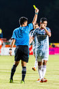 Sisaket thailand july the referee blue show the yellow card during thai premier league between fc and chainat hornbill fc Royalty Free Stock Images