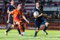 Sisaket thailand september piyawat thongman of sisaket fc orange in action during friendly match between and roi et utd Stock Photos
