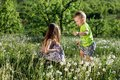 Dandelion field white girl boy happy little baby green meadow yellow flowers dandelions nature park garden two family sister broth Royalty Free Stock Photo