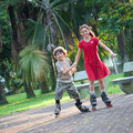 Sister and brother having fun rollerblading Royalty Free Stock Photo