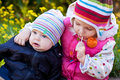 Sister and brother outdoor little baby outdoors in spring Royalty Free Stock Photos