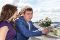 Sister calming young groom before wedding process outdoors Royalty Free Stock Photos