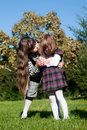 Sisters in autumn park Royalty Free Stock Photos