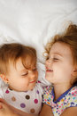 Sisters in bed young playing Royalty Free Stock Photography