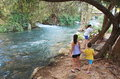 Sisters and brother on the jordan river at hazbani one of streams feeding main in north of israel Stock Photo