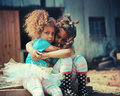 Sisters comforting each other two young girls hug and comfort outside Royalty Free Stock Photos