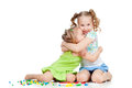 Sisters girls playing and embracing Royalty Free Stock Photos