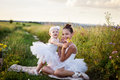 Sisters involved in the field of ballet girl teaches her sister to Royalty Free Stock Photography