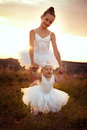Sisters involved in the field of ballet girl teaches her sister to Stock Photography