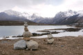 Sisters lake the tibetan praying stones on bank of in batang sichuan china Royalty Free Stock Image