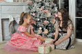 Sisters near a christmas tree two Royalty Free Stock Photography