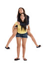 Sisters on piggyback Royalty Free Stock Photos