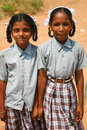 Sisters walking back from school in india varkala october two unidentified and posing front of the camera while they are holding Royalty Free Stock Photography