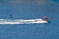Sit down hydrofoil ski sport speedboat on blue sea Royalty Free Stock Photo