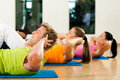 Sit-ups in gym for fitness Royalty Free Stock Photo