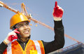 Site manager with safety vest talking mobile phone under construction Royalty Free Stock Photos