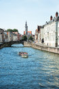 Site seeing in bruges tourists on a canal boat ride belgium Stock Image