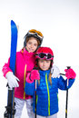 Siters kid girls with ski poles helmet and snow goggles Royalty Free Stock Photography