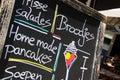 SITTARD, NETHERLANDS - JUIN 29. 2019: Close up of hand written menu on black chalk board of durch restaurant