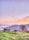 Sitting bench with sun rising on a hill top sunrise Stock Photography