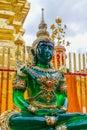 Sitting Buddha golden statue inside the wat thai temple
