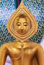 Sitting Golden Buddha statue in Thai Buddhist Temple Royalty Free Stock Photo