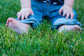 Sitting in grass Royalty Free Stock Photo