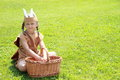 Sitting little indian girl with wicker basket Royalty Free Stock Image