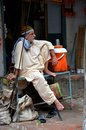 Sitting man relaxes in lahore pakistan september a sits on a metal table outside his small shop an alley the old walled city of Stock Photos