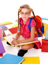 Sitting schoolgirl in eyeglasses with books. Stock Image