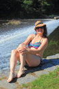 Sitting at the weir girl in swimming suit Stock Photos