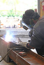 Sitting welding with measuring Royalty Free Stock Photo