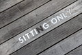 Sitting only words written on wooden board Royalty Free Stock Photography