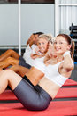 Situps in gym Stock Images