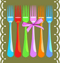 Six bright color forks over green Royalty Free Stock Photo