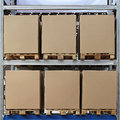 Six carboard boxes at pallets in distribution warehouse Royalty Free Stock Photo