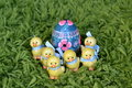 Six ceramic easter chickens guarding painted egg Royalty Free Stock Photos