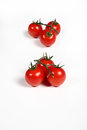Six cherry tomatoes on white Royalty Free Stock Photo