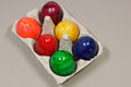 Six colored eggs in a box Royalty Free Stock Photography